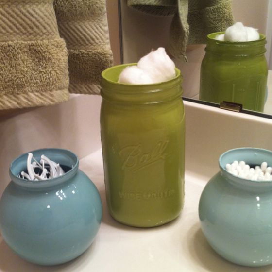 I painted these jars to hold cotton balls, floss, and cotton swabs..2 shades of blue and lime green. One is a mason jar and 2 are small vases
