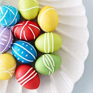 Create patterns on your Easter eggs:  Cover egg with rubber bands and submerge in dye bath. When egg reaches desired color, remove. Carefully snip off bands with scissors and blot dry.