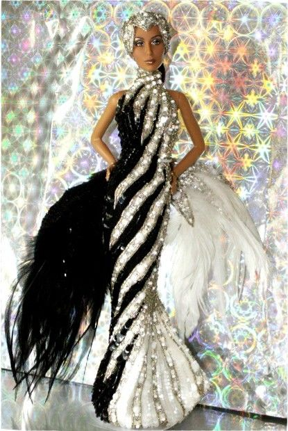 KB Exclusive Cher doll has been rebodied & redressed in Barbie's Bob Mackie's 1991 Starlight Splendor gown. Bob Mackie originally designed a similar version of this gown for the Cher doll by MEGO in 1976, then augmented it considerably and resold the design to Mattel as the 1991 Starlight Splendor Barbie!