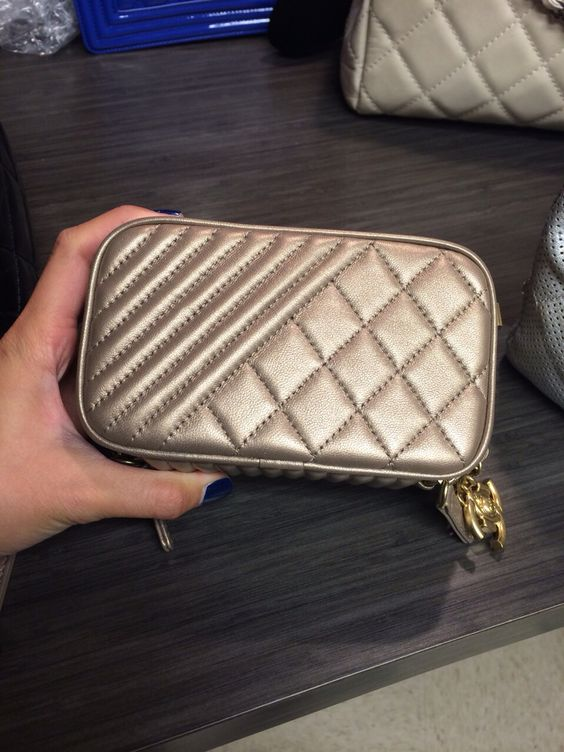 Just like my Henri Bendel No. 7 quilted camera bag that I tote my Leica minus the Chanel's price tag!!!