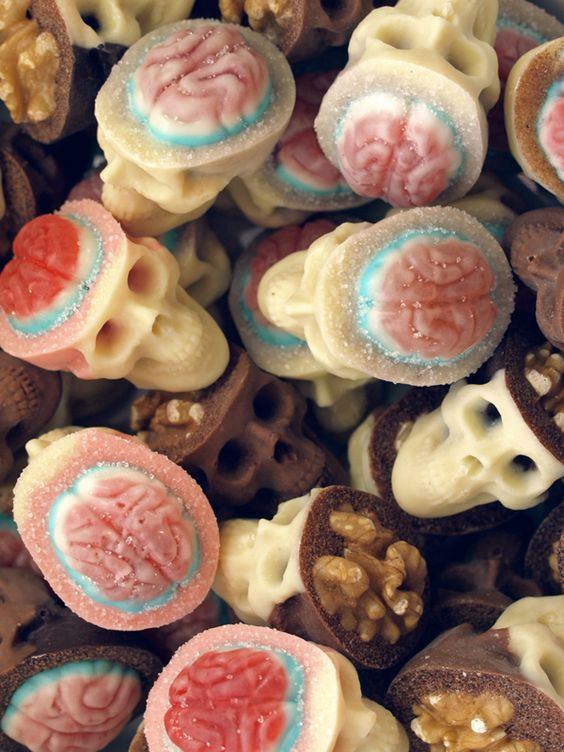 Chocolate Sugar Skulls with walnut and candy brains. Ridiculously cool.