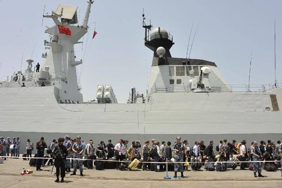 449 Chinese citizens wait to get on the a navy frigate to leave Yemen, in the al-Hodayda port in western Yemen, on March 30. 122 other Chinese nationals were evacuated from the Yemeni city of Aden and have already arrived in Djibouti. (Hani Ali)
