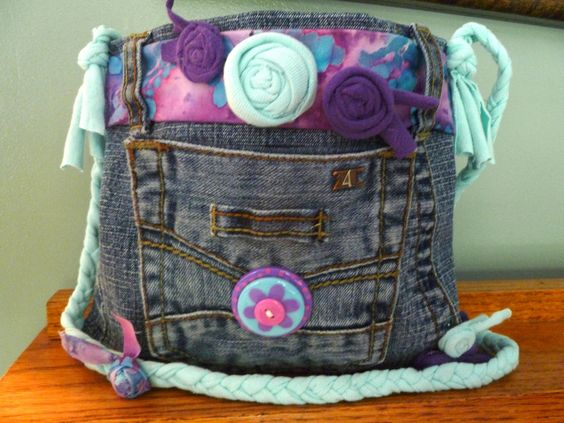 Small handbag made from recycled blue jeans, fabric scraps, tee shirt, and buttons.