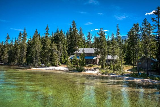 A once in a lifetime opportunity awaits. Imagine 275 private feet of white sandy beach along spectacular Priest Lake, 20 wooded acres, more than 2000 feet of a naturally wooded creek meandering through the property, a 5 bedroom 3.5 bath Scandinavian-inspired modern cedar log home beautifully designed to complement the rustic landscape, a secluded guest cabin with full kitchen able to sleep 4, a beach front boat storage building, and a generous dock providing a canopied boat slip.