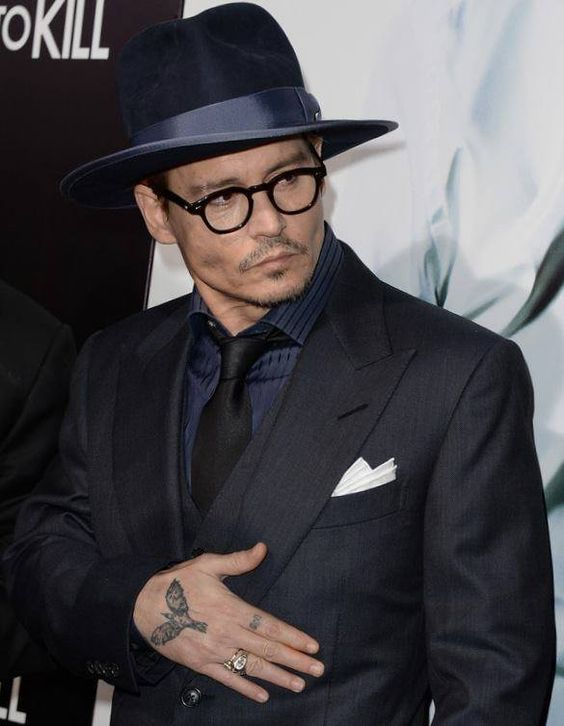 Johnny Depp and Amber Heard enjoy rare PDA as she flashes diamond ring and lots of leg in slit dress at 3 Days To Kill premiere