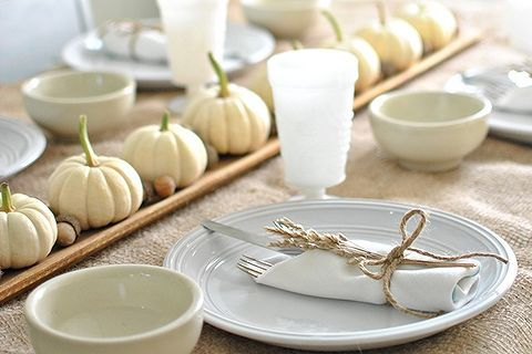 simple fall decorating with baby boo pumpkins, seasonal holiday d cor, Line Baby Boos and acorns on a French bread board to use as a centerpiece