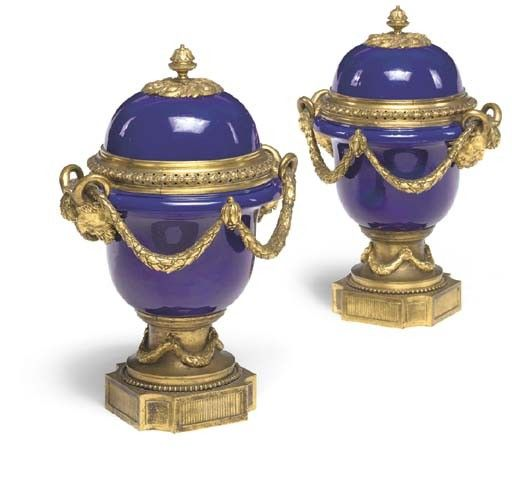A pair of Louis XVI style ormolu-mounted cobalt-blue porcela