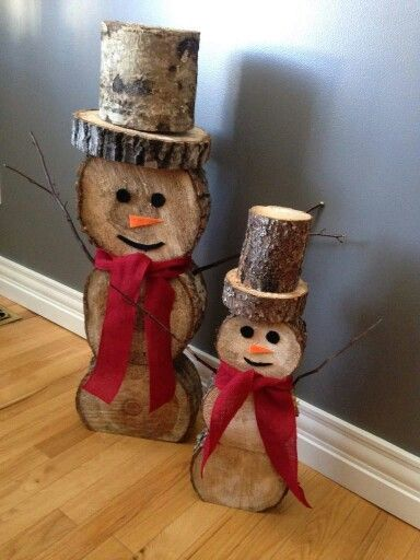 These two DIY Christmas snowmen are made from wood offcuts - they can stand up on their own - you could make them any size you like