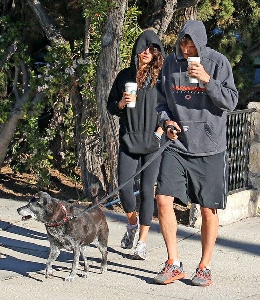 Mila Kunis Photos - Couple Ashton Kutcher & Mila Kunis take their dog for a walk in Hollywood, California on January 7th, 2013. Ashton and Mila are in no mood to be photographed and stay hidden inside of their hoodies. - Mila Kunis & Ashton Kutcher Hide Inside Of Their Hoodies