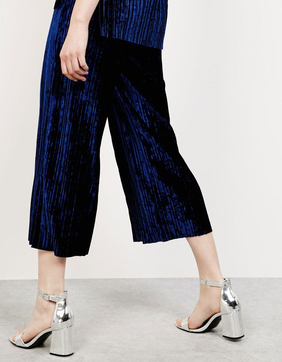 The perfect way to do pared-down party: a velvet co-ord with liquid metallic heels.