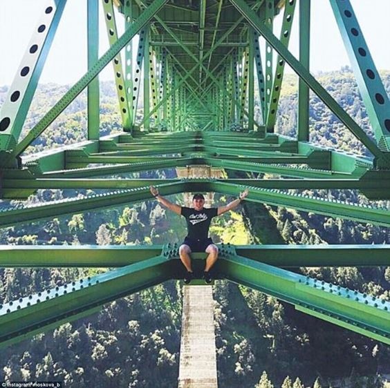 Shocking photos show young thrill-seekers posing for daring photos on the 730-foot-tall Foresthill Bridge near Sacramento in California: