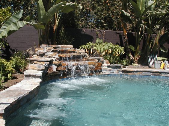 Swimming pool with rock waterfall outdoor ideas for Swimming pool waterfalls construction