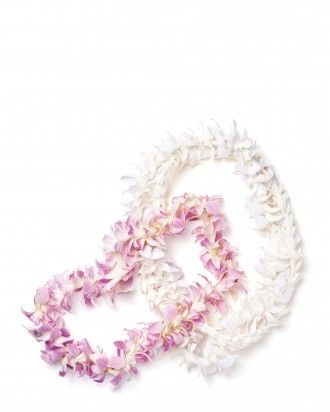 Hawaii Wedding: Edge your aisle or style the center of your reception tables with traditional Hawaiian leis (from $15.75, hawaiianleicompany.com).