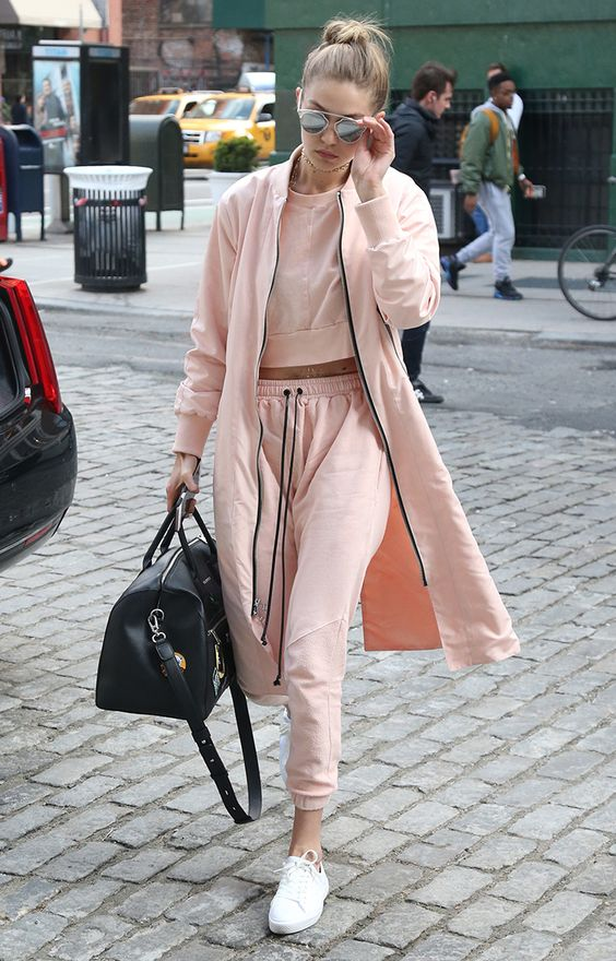 Gigi Hadid just turned the whole idea of a trackie on its head with this three-piece blush suit, with a longline bomber jacket and fresh white sneakers. Guess this is what they mean when people say tracksuits can be chic.: