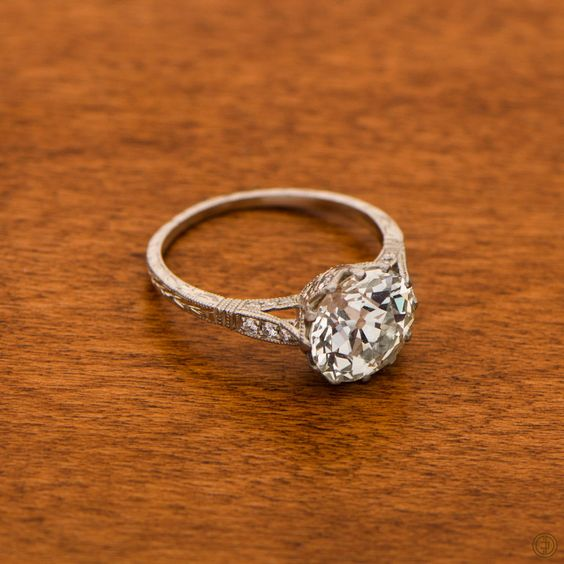 A classic Vintage Diamond Solitaire Engagement Ring, expertly set in a remarkable platinum and diamond mounting.
