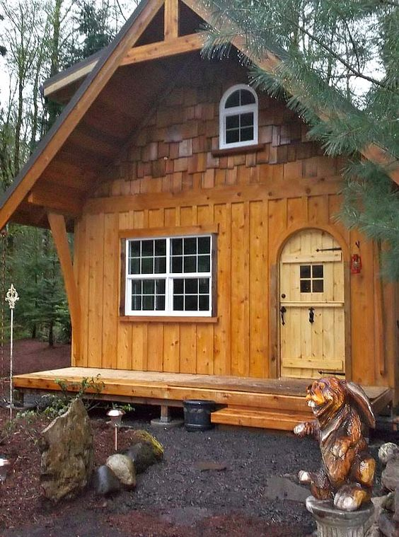 This tiny fairy tale cottage with its 16x16 footprint and 2 full