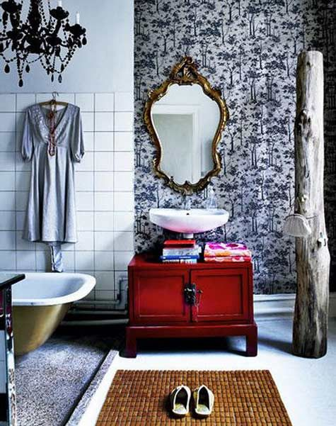 Red bathroom cabinet, altho small gives a huge burst of colour to the black and white room