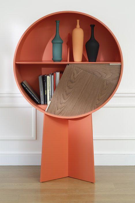Patricia Urquiola's Luna cabinet conceals items behind pivoting doors.