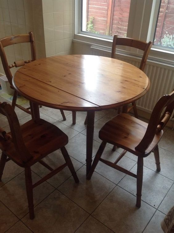 Solid Pine Kitchen Table with fold down sides. 4 solid pine chairs | London | Gumtree