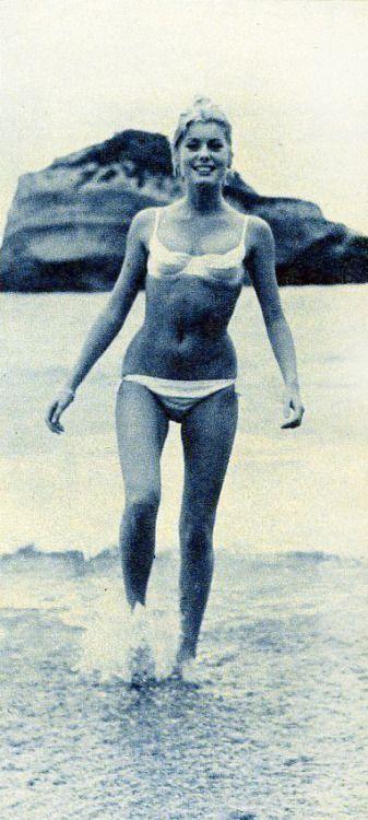 Catherine Deneuve in white bikini. 1960s.
