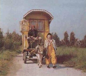 pipo de clown en mamalou....rijden recht door zon en regen.....langs de wijde wereld wegen...