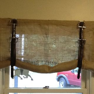 Cute idea for a window treatment and so simple. Burlap, stirrup straps and horse bit!