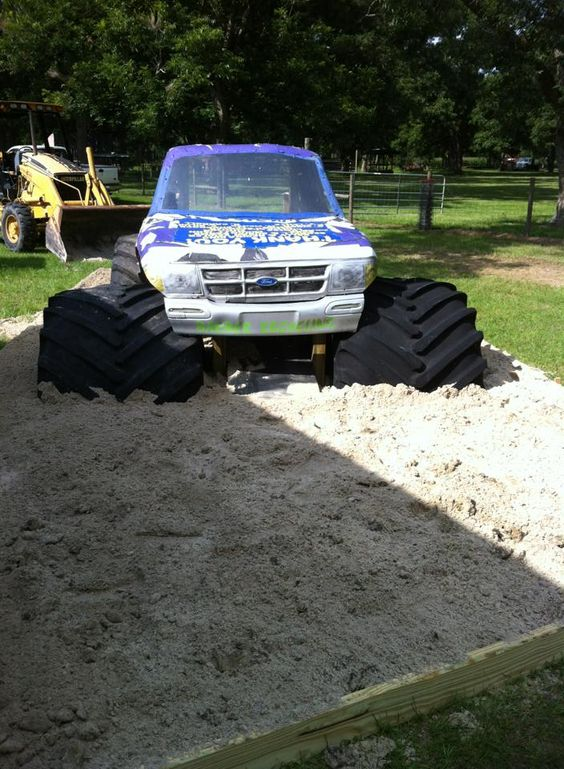 Old monster truck parts made into a sanbox playground www.crcint.com