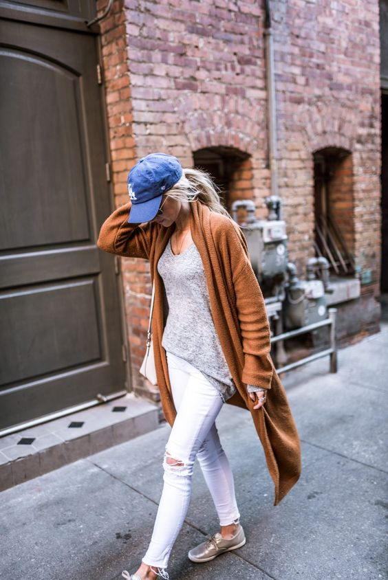 Slouchy oversized sweater + distressed denim + baseball cap
