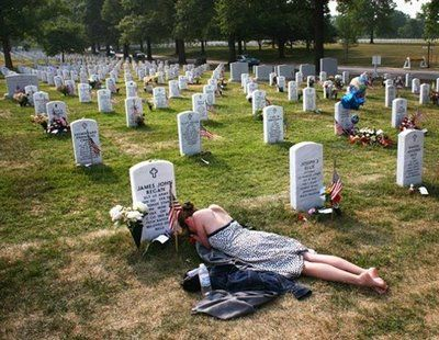 """Mary McHugh mourns her slain fiancé, Sgt. James Regan, a US Army Ranger killed in Iraq, at Arlington National Cemetery May 27, 2007.    If you Google """"James John Regan,"""" you will be able to read much about this young man"""