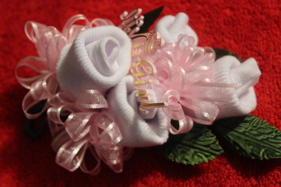 Baby Socks Corsage for baby shower by TouchofClassbyAdri on Etsy https://www.etsy.com/listing/180675933/baby-socks-corsage-for-baby-shower