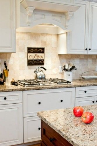 Cream cabinets with new venetian gold granite and tumbled marble backsplash and a dark stained - Black granite countertops with cream cabinets ...