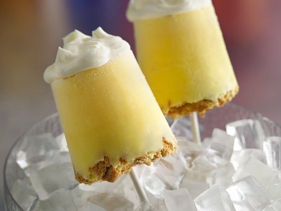 Lemon Meringue Pie Pops: (With a link to 12 more recipes for pops) -  What could be better than a slice of pie? Pie pops! This frozen take on lemon meringue pie has a graham cracker crust, creamy lemon filling and a fluffy topping. Basically it's your own little piece of heaven–on a stick!