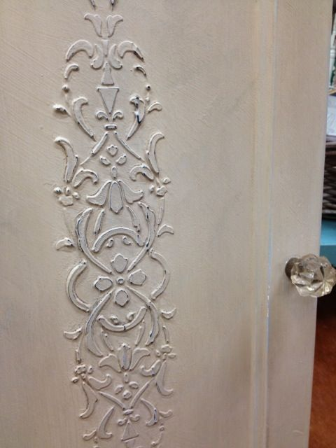 Maison Blanche makes a product called Glacage. It can be used to make lovely raised patterns through stencils. Paint and distressed = beautiful: