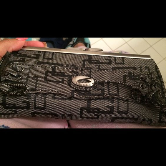 Brand new guess clutch Selling this brand new beautiful guess black cluth , it is perfect for a night out on the town. Guess Bags Clutches & Wristlets