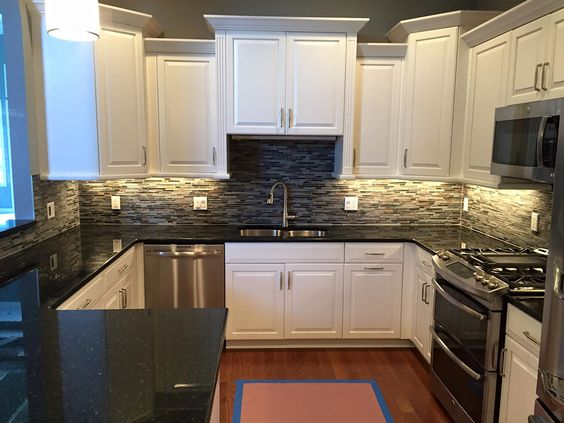 These cabinets are nearly pure black with just a little bit of flecking throughout so you get a very ritzy look. You also get a good accent with white cabinets or with the backsplash here.