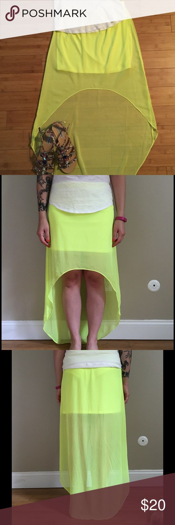 """⬇️REDUCED❗️Express Neon Hi-Low Maxi Skirt Neon yellow skirt. Color is most like modeling photos. Hi-low style. Sheer with mini skirt lining. Elastic waist. Can fit a small as well. Worn a few times and in excellent condition, except for a tiny stain the size of a pen dot on front near elastic. Extremely hard to see. Approximately 13 1/2"""" across the waist when laid flat. Approximately 16"""" at shortest point and 39"""" at longest. Lining is approximately 13 1/2"""" long. 100% polyester Express Skirts…"""