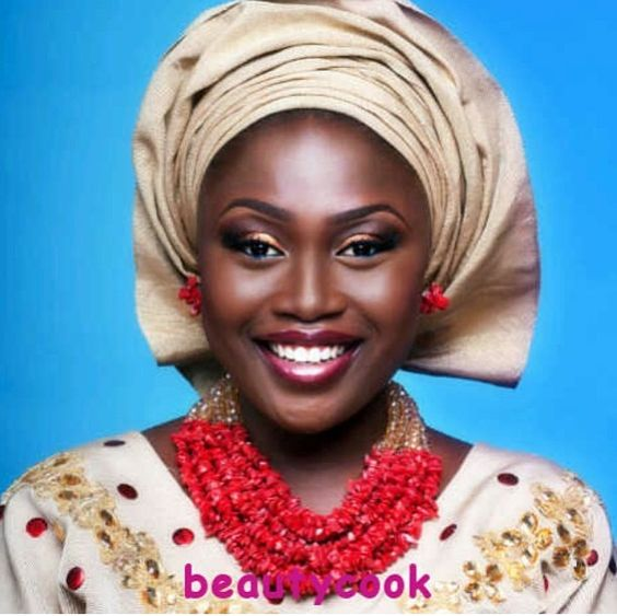 Nigerian bride is traditional coral beads and gele. Makeup by Beauty Cook Studio.