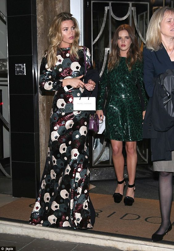 Family affair: On Monday evening model and TV personality Abbey Clancy left Claridge's Hotel with her teenage sister Elle before heading to a LOVE Magazine party at Loulou's