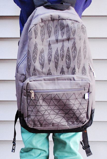 use a sharpie to decorate a canvas back pack. the options are endless!
