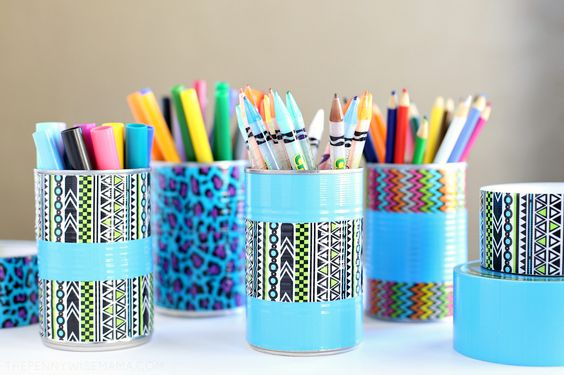 Now that my kids are in school, I've been working on getting our home organized. First on my list -- tackling my kids' art supplies. My twin girls love to color, paint, and do crafts so we have tons of art supplies that take up a lot of space and tend to get mixed up in different storage containers. I made this fun DIY pencil holder and art organizer, featuring upcycled cans and Duck Tape, to help keep my girls' markers and colored pencils organized. I love how it turned out! These unique pencil