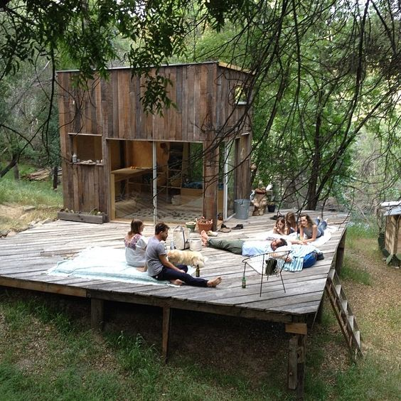 That's what I'd do if I had a cabin. Build a big flat deck and stay outside all the time. I love it.