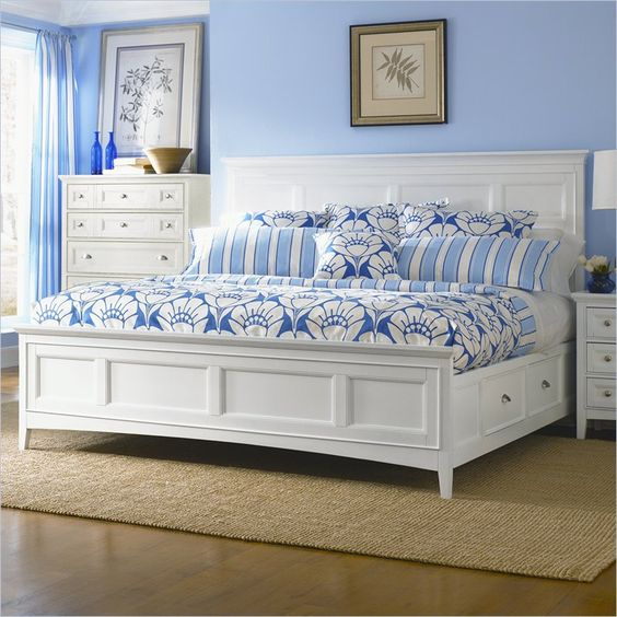 A white panel bed with four under-bed storage drawers, a crisp white finish, and nickel pulls. The clean lines of this piece make a subtle statement of sophistication and elegance.