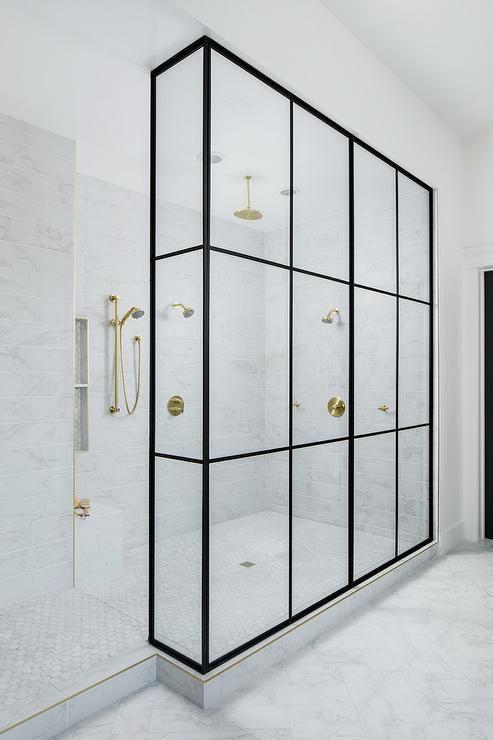 Marble Herringbone Bathroom Floor Tiles Lead To A Walk In Shower