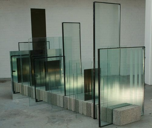Glass Factory Rejects, mirror, concrete. The dimensions of the work are: 285cm x 122cm x 180cm Spectacle of a Foreboding Structure by Carl Slater