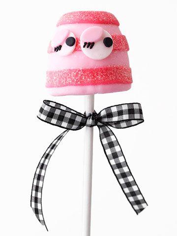 Pink Stripe Monster Brownie Pop        Pink fondant plus curly eyelashes give this Brownie Pop a sweet, feminine look.