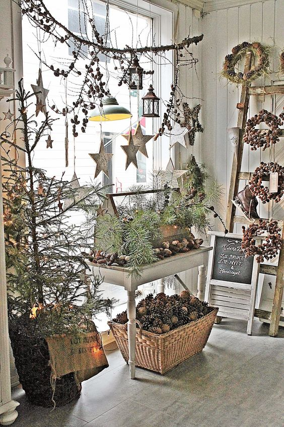 Scandinavian Christmas - store window display with hanging lanterns, stars, pinecones