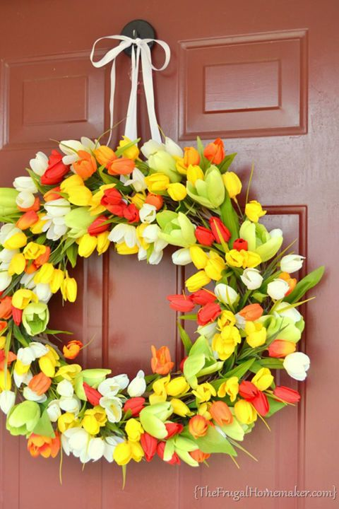 Spring Tulip Wreath: Greet guests with lush, colorful tulips this Easter. Click through to find more DIY Easter wreath ideas for your front door.