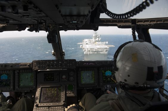 CARIBBEAN SEA (July 19, 2014) A tilt-rotor MV-22 Osprey prepares to land aboard the future amphibious assault ship USS America (LHA 6).  America is traveling through the U.S. Southern Command and U.S. 4th Fleet area of responsibility on her maiden transit. The ship is scheduled to be commissioned Oct. 11 in San Francisco. (U.S. Navy photo by Mass Communication Specialist 2nd Class Ryan Riley/Released)