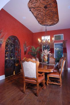 This makes me want to get a wrought iron gate to put in the archway between my kitchen and dining room!