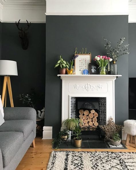Dark Grey Walls With White Fireplace And Wooden Flooring Living Room Wall Color Room Wall Colors Vintage Living Room Design